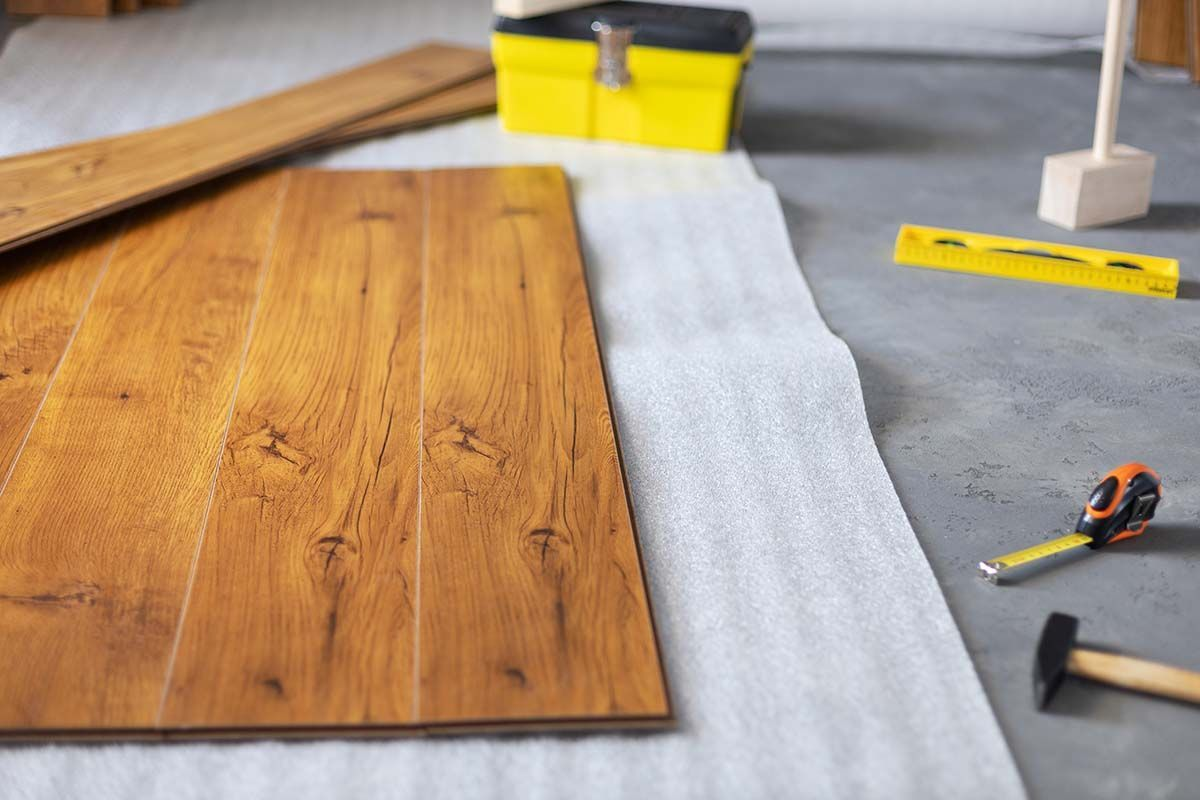 Laminate floor background texture and tools. Wooden laminate flo